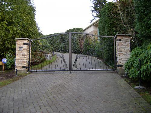 Custom ornamental aluminum gate designed as a tree, branches, and leaves.