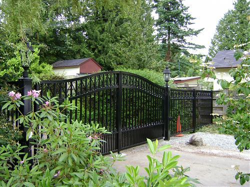 custom design driveway gate, made from thick aluminum picket and railing to matc