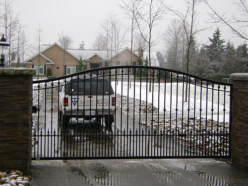 Always a favorite; arched aluminum driveway gate.